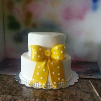 Small Round Wedding Cake Fondant cake with large cheery fondant bow. The cake was small as it was part of a larger dessert table featuring over 200 cupcakes