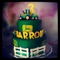 John Deere Cake Fondant (airbrushed) decorations made from gumpaste. Logos on cake printed on edible paper.