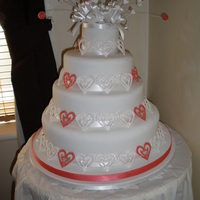 Wedding Cake Hearts And Sparkle fruit cake three stacked cake with sparklred lacy hearts