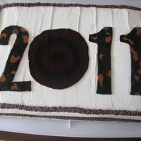 Camo Graduation Cake The target doesn't show up very well in the picture of the actual cake. The additional photo shows it a little bit better.