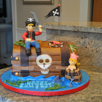Pirate & Princess Birthday Cake This cake was made for a friend of mine whose little boy and girl had birthdays close together. She wanted a pirate cake with a little...
