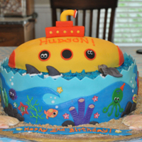 The Yellow Submarine Birthday Cake This was my youngest son's 2nd birthday cake. The yellow submarine looks like the invitation, and the sea scape was just a lot of fun...