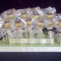 Graduation Cake Pops   graduation smily face pops on a stand for a little boy graduation frist grade.