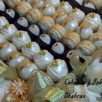 Wedding Cake Balls   peach and gold themed wedding cake balls diamond ring, bride, groom, stripes.