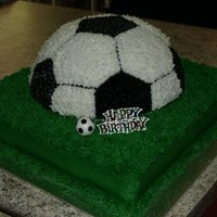 Soccer Birthday Cake Bottom tier is choc sponge, ball is vanilla sponge. Made this for a boy's 9th birthday party.