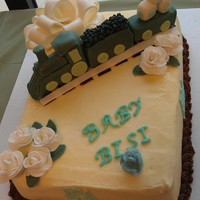 Cake With Modeling Chocolate Train For A Baby Boy Made a cute cake for a co-worker. First flowers I ever made and first time working with modeling chocolate. I learned a lot about both...