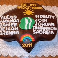Lexis Girl Scout Troop Cake Cake I made for my neices Brownie troop. Chocolate cake with chocolate filling. All symbols handmade out of fondant