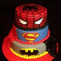 Superhero I made this cake for my son's 6th birthday, he couldnt make his mind up what he wanted so i made him all 3 :O)