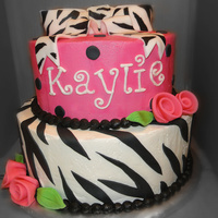 Zebra & Hot Pink Girly Cake  I was asked to do a two tiered cake with a bow on top and using zebra print with hot pink. This is what I came up with, using a couple of...