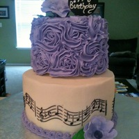 Musical Birthday Cake iced with bc, fondant flowers, royal icing musical stencil