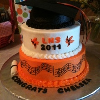 High School Graduation Cake iced in bc, hat topper (the flat part) is foam and ribbon, mmf decor accents...school colors orange and black and are the yellow jackets...