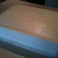 White Communion Cake iced in bc, decor is royal icing, cross traced and all floral is stencil