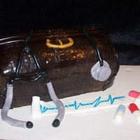 Doctor Bag This doctor bag is made of red velvet cake with creamcheese filing and chocolate fondant.