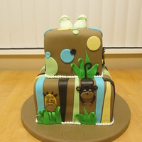 Jungle Safari Baby Shower Cake Jungle themed baby shower, gumpaste baby shoes on top by request. Lions, giraffes and monkeys.