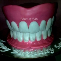 Denture Cake cake for a dental technician. sugarpaste teeth were individually weighed & handmolded.
