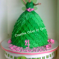 Tinkerbell Doll Cake   my first all fondant dolly cake vanilla cake filled with vanilla cream with 3 tones of green fondant leaves.