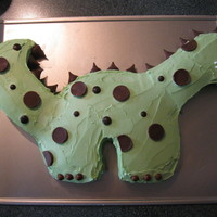 Dinosaur Cake This is a cut out cake I made for my grandson's 1st birthday. It is a yellow cake with white icing colored green. I used candies for...