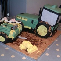 John Deere Tractor   Chocolate cake tractor and trailer with marshmallow wheels.