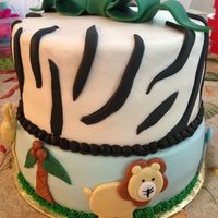 Zebra And Lion Smoothed buttercream with fondant accents