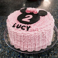 Minnie Mouse Ruffled Cake 8 inch round covered in ruffled buttercream.