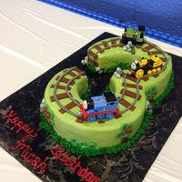 Three Thomas The Train Used two 8 inch rounds covered in smoothed buttercream with fondant accents