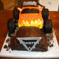 Monster Truck Jam Birthday Party El Toro Loco driving into a 3 tiered cake!