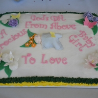 Garden Themed Baby Shower Cake The baby is laying in a basket surrounded by flowers & grass &butterflys. Roses are made out of royal icing, butterflys &...