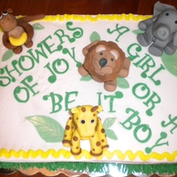 "Safari Themed Baby Shower Cake Safari themed baby shower with fondant & gumpast animals. Sex of child is unknown, hence the writing on the cake of ""Showers of..."