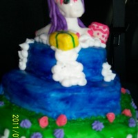 My Little Pony 1St Birthday Cake My niece plays with her big sister's Baby Sweetie Belle Pony all the time so the wanted a cake to reflect that. Vanilla cake with...