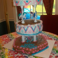 "Carousel Bottom tier is chocolate pudding cake with my ""Barely There Fudge"" icing. The next 2 tiers were vanilla with butter cream. The..."