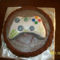 Xbox Junkie BF son spends hours on the game so he got his fav thing in this cake. Bottom is a yellow cake with chocolate buttercream icing. The...