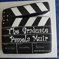 Clapperboard Gradulation Cake   Graduation Cake for a film lover. This was a 12'x12' cake on a 16' barrelboard with black satin ribbon detail.