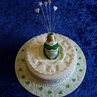 25Th Wedding Anniversary Cake   25th Wedding Anniversary Cake in Green and White with Champaigne Bottle and Flooded collar.