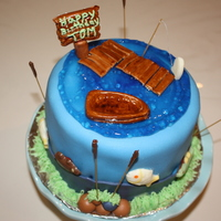 Birthday Fishing Cake 6 inch round vanilla cake with chocolate buttercream filling. Covered in fondant. Fish are made of melting chocolate. All other accents are...