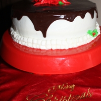 Christmas Poinsetta Cake Chocolate fudge cake with chocolate chips in batter. Filled with whipped chocolate ganache, iced in buttercream then topped with chocolate...