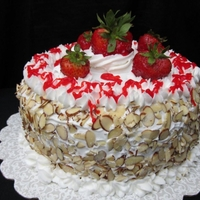Strawberry Almond Layer Cake Almond flavored cake filled and topped with fresh strawberries and almonds and white chocolate buttercream
