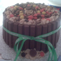 Reeses Pb Choc Ganach Cake Reeses pb cake w pb mousse filling w choc ganache,and mousse on top and kit kats wrapped around out!:)yum
