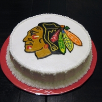 "Chicago Blackhawks This is a one layer 8"" round cake iced in buttercream. The logo is a frozen buttercream transfer."