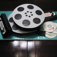 "Movie Fan Cake The film reels are one layer 10"" rounds, the VHS tapes are 9x5 loaf, and the CDs are fondant."