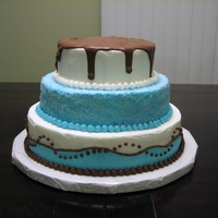 "Blue Tiered Cake 6"", 8"", 10"" one layer rounds. The top tier has a milk chocolate drip, the middle tier has white Wilton Sparkling Sugar and..."
