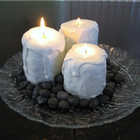 Burning Candle Cakes These cakes were made by cutting a jelly roll cake into three sections. They are dipped in white chocolate. The rocks are fondant. The...