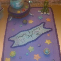 Marvin The Martian  I made This cake for a friend ,40. Bday...space ship is made of cake the lower part and top was made using rice crispies ..use fondant to...