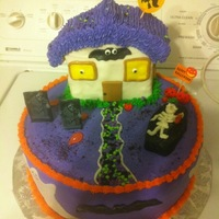 Halloween Cake   Made This cake for a work raffle , it was fun making This cake ,it was a hit ...