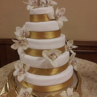 Gold Orchid First Quince Cake This is my first quinceanera cake. 5 tier peach filling cake with natural orchid flowers