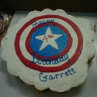 Captain America Cupcake cake and matching sugar cookies.
