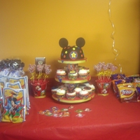 Mickey Mouse Cake And Cupcakes Mickey mouse cake and cupcakes made for my little man 3rd Birthday.Strawberry Swirl,Lemon Lime cupcakes and Vanilla cake topper.Fondant...