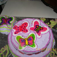 Butterfly Cake The first time I ever painted a design on fondant, and I think the last!! This was for my neices first birthday, the small butterfly in the...