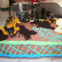 Road Construction Cake This is the second cake I ever made and the first with no help at all. I wanted something with tractors for my little boy's second...