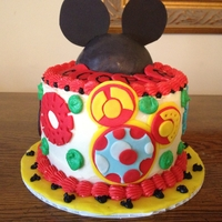 Mickey Mouse Clubhouse Cake This was for a little boy's Birthday. Molded the Mickey Mouse head out of chocolate then covered it in fondant.