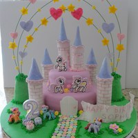 My Little Pony Themed Cake For A 2 Yr Old  This is my 1st fondant cake and 1st big project. It took me 2 weeks as I made all the items from scratch. The towers are made from gumpaste...